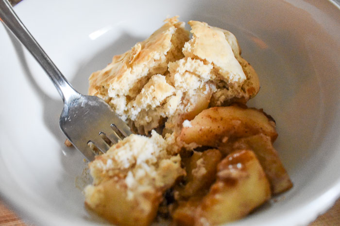 Simple Spiced Pear Cobbler is made with an easy scratch filling of crunchy pears and warm spices, and lightly sweet bisquick biscuit topping. Perfect for Fall and Winter when pears are in season! Recipe by Dash of Jazz