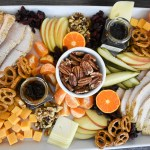 overhead view of a colorful and festive thanksgiving appetizer board
