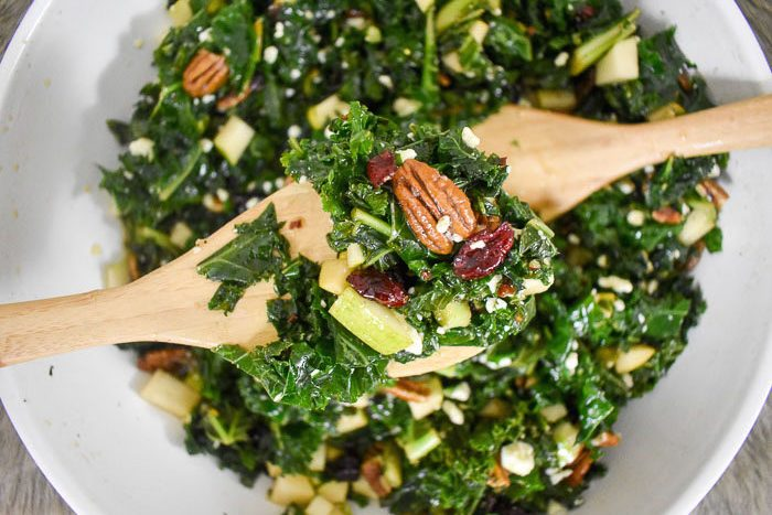 massaged kale salad with pecans, cranberries, chopped pear, blue cheese, and homemade dressing