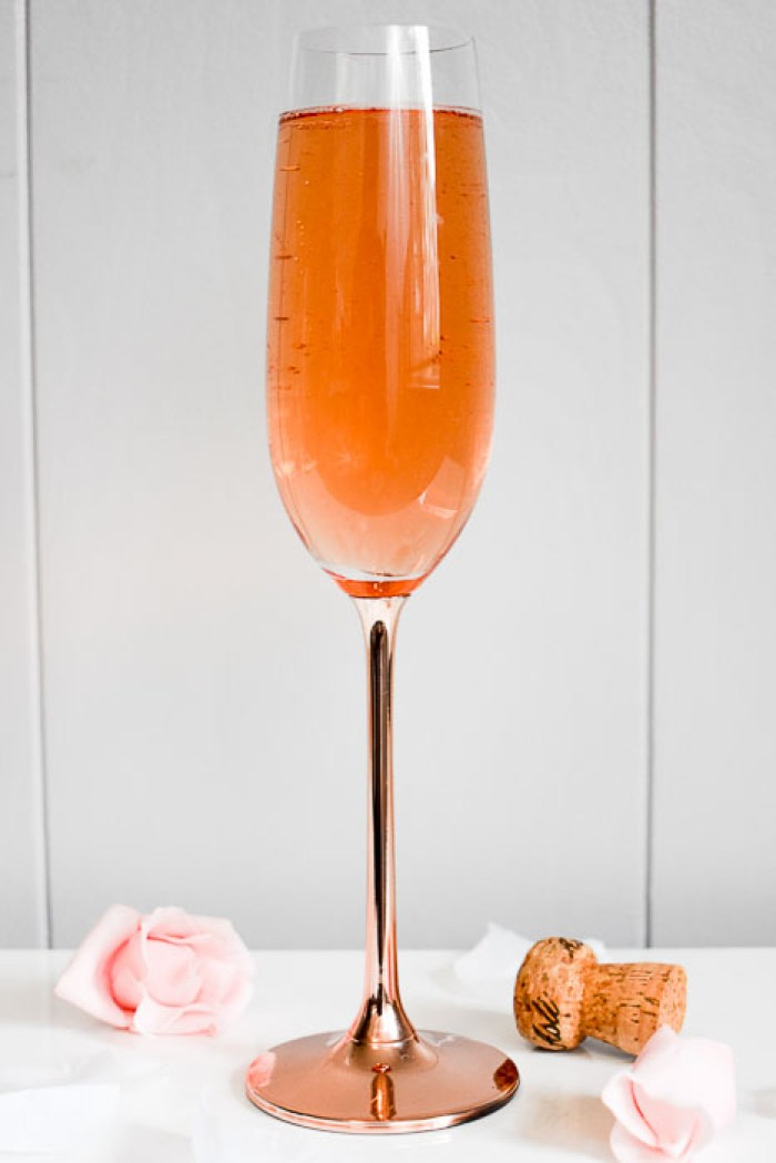 blushing bride cocktail in a rose gold champagne flute