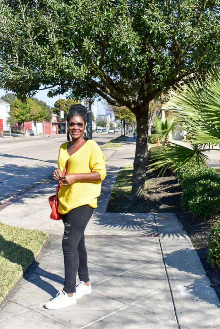 woman in yellow sweater on sunny day on Almeda Road in Houston, Texas