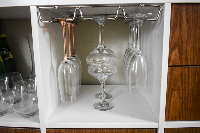 wine glass rack installed on an IKEA Kallax shelf