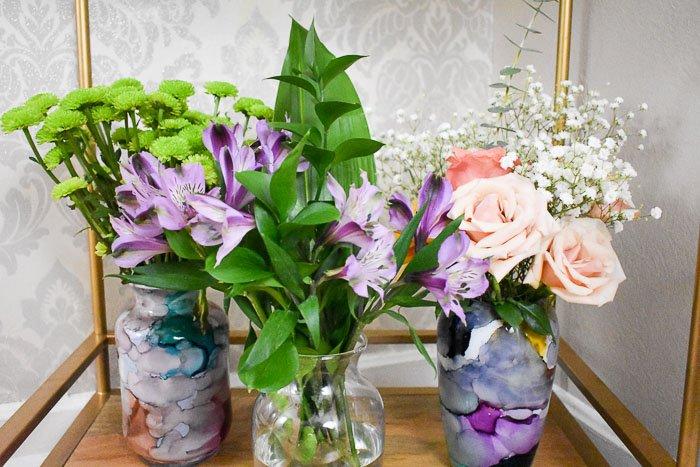 three floral arrangements on a bar car