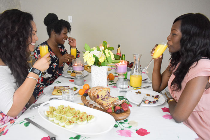 women drinking mimosas at brunch