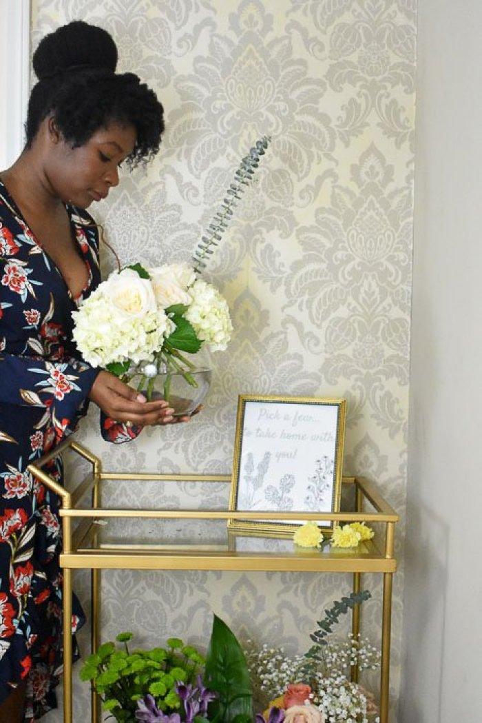 woman holding arrangement of garden roses, hydrangeas, and eucalyptus