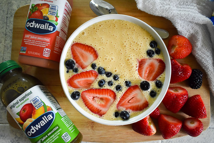 Smoothie bowl made with Odwalla Citrus C Monster topped with blueberries and sliced strawberries
