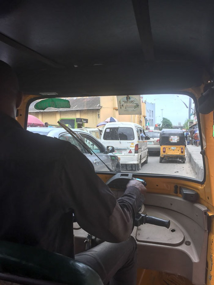 View from the backseat of a keke ride in Balogun, Lagos, Nigeria