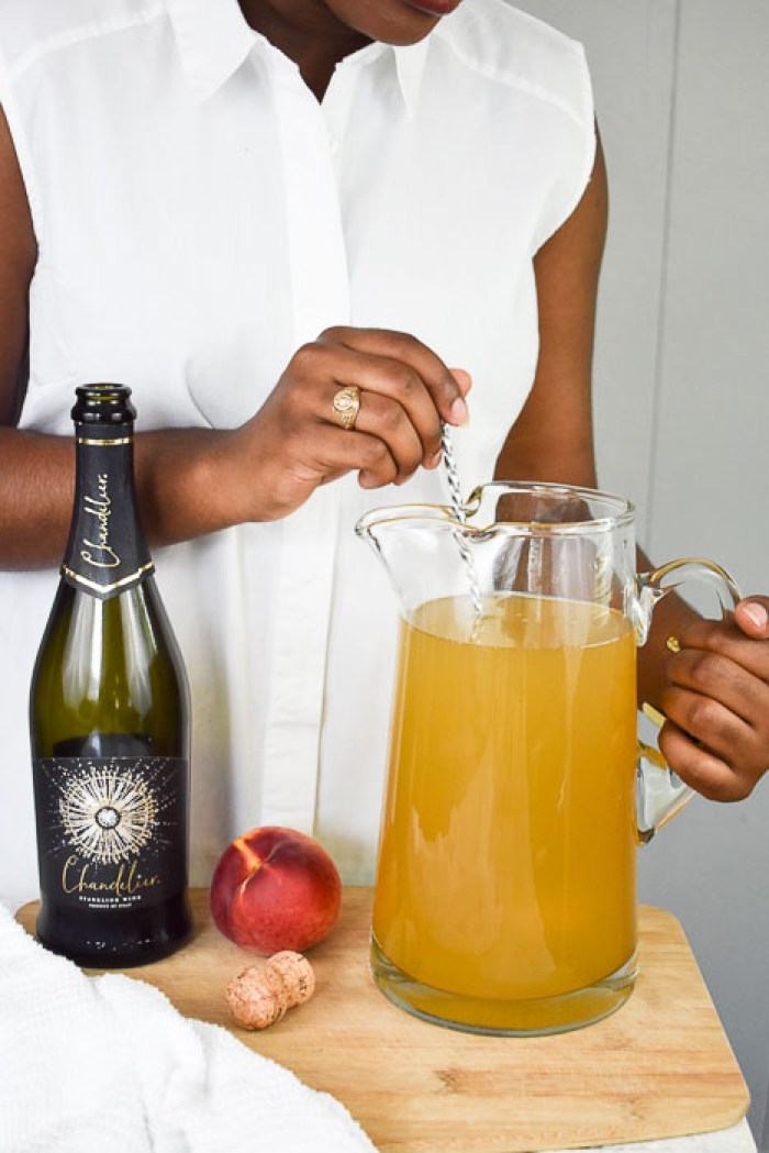 Dash of Jazz stirring pitcher of lemon ginger bellini punch