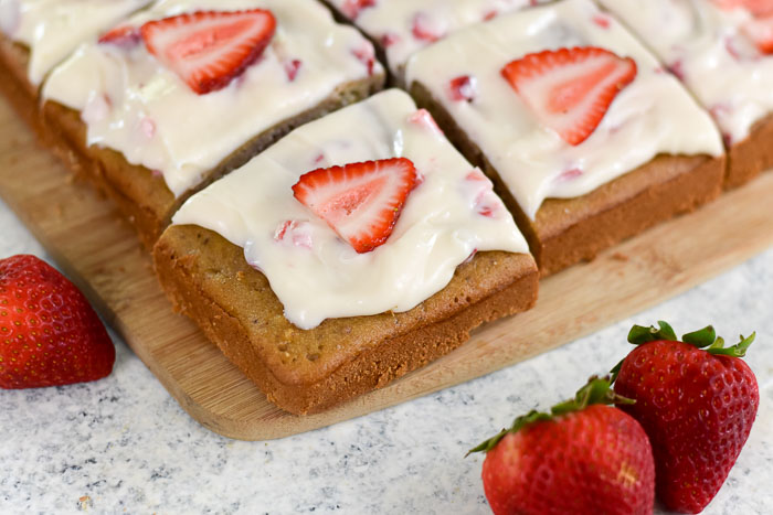 corner piece of a decorated strawberry cream cheese sheet cake