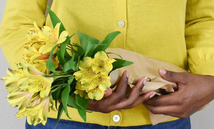 holding yellow alstroemerias