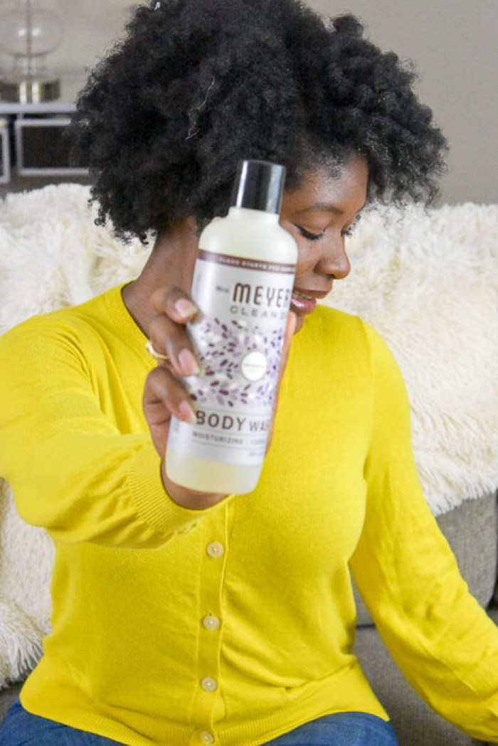 holding bottle of Mrs. Meyer's Lavender Body Wash