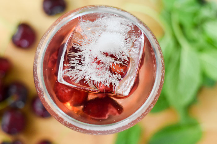 cherry rosé spritzer with large ice cube