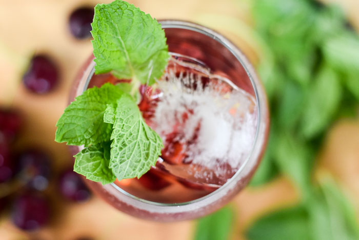 cherry rosé spritzer garnished with mint
