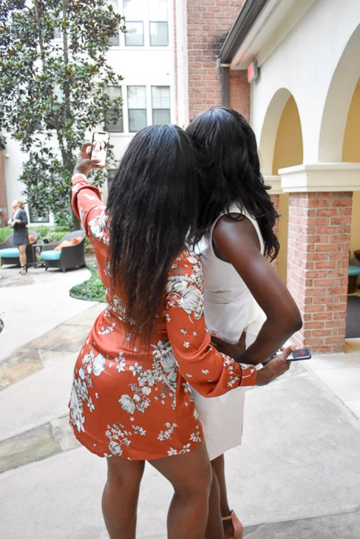 women taking bridal shower selfie