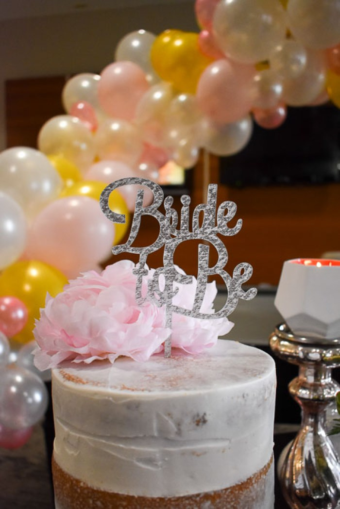 silver bride to be topper on bridal shower cake