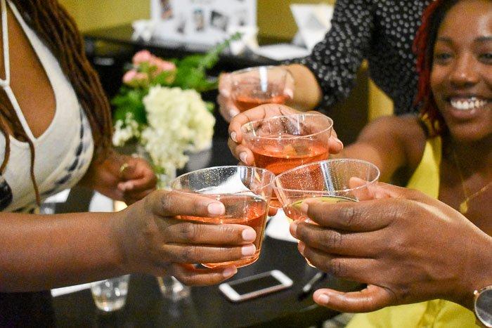 women toasting rose cocktail at bridal shower