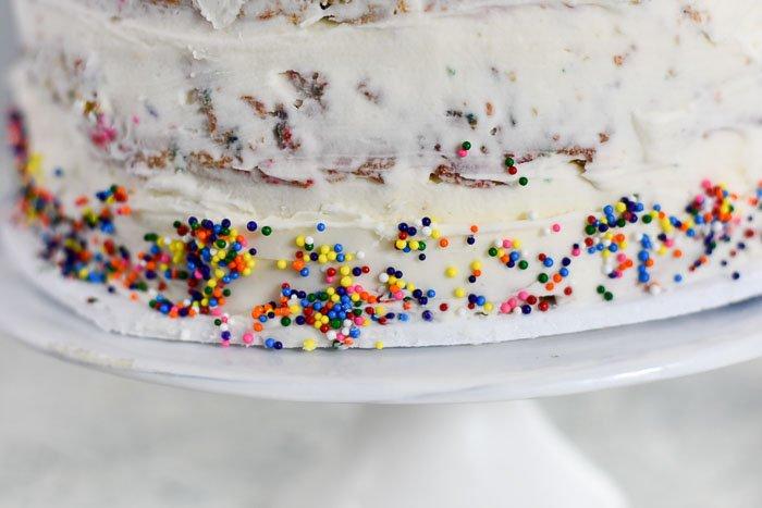 rainbow nonpareil sprinkles on cake
