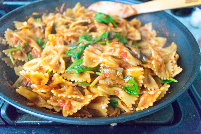pasta skillet dinner with bowties, spinach, and sauce