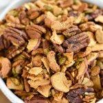 bowl overflowing with delicious apple cinnamon grain free granola