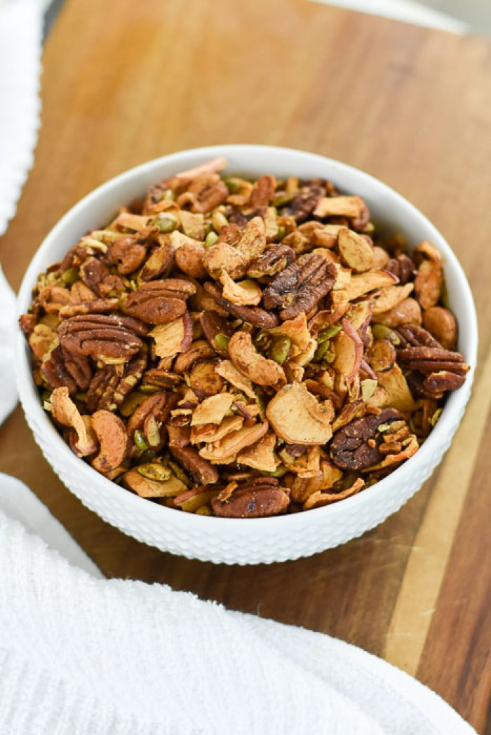 bowl of apple cinnamon grain-free granola on cutting board