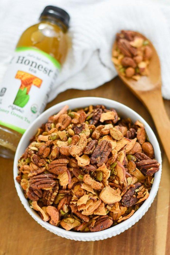 bowl of apple cinnamon grain-free granola and bottle of Honest Tea