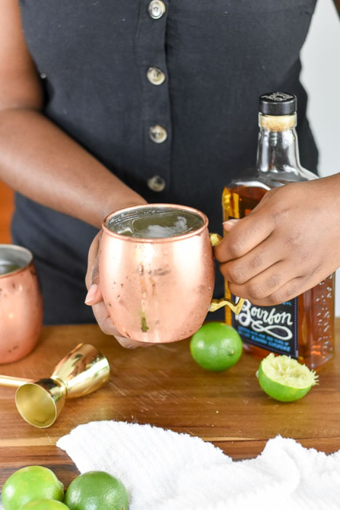 holding bourbon mule cocktail