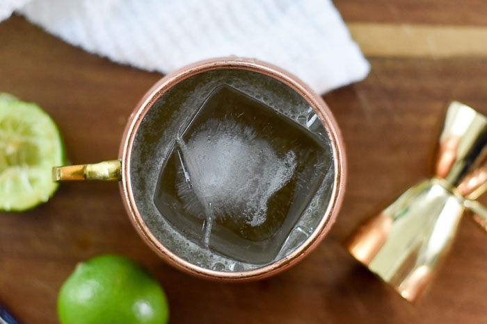 bourbon mule cocktail with giant ice cube