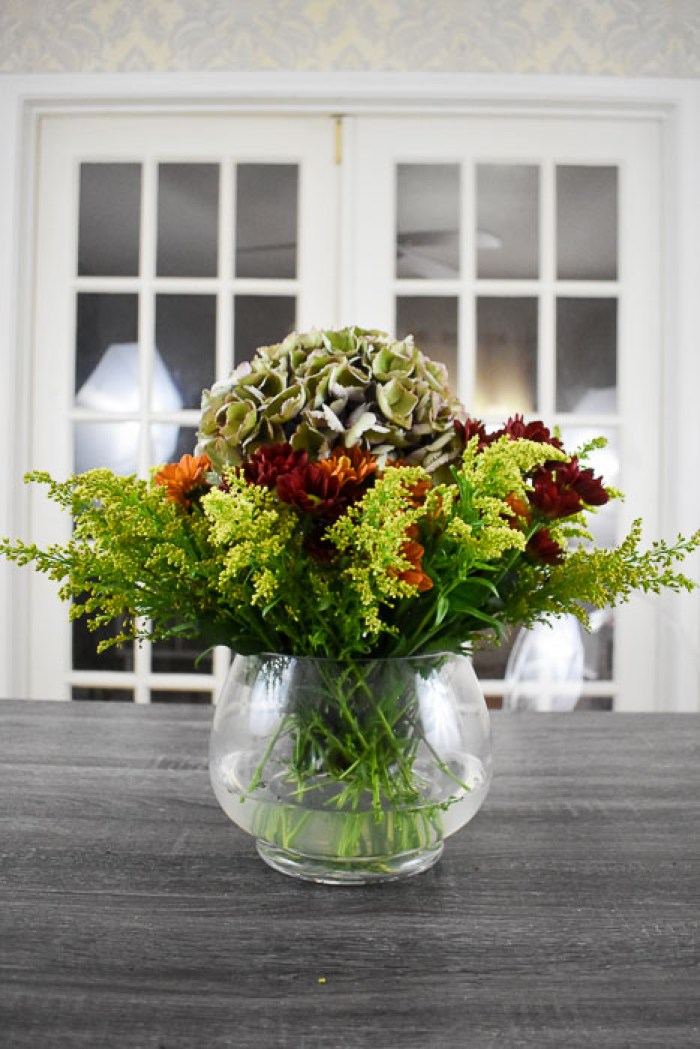 finished fall flower arrangement with goldenrod, pom pons, and antique hydrangea