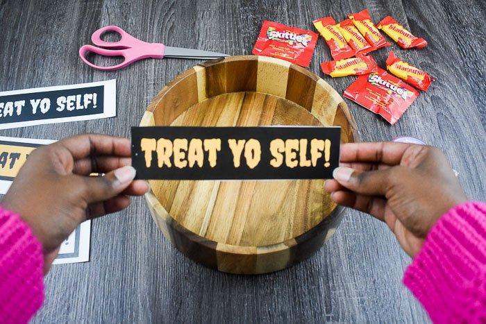 holding treat yo self cutout