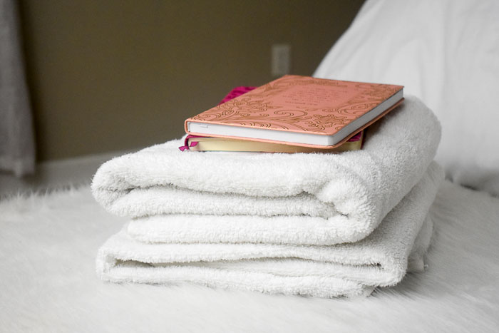 journals stacked on top of fresh white towels