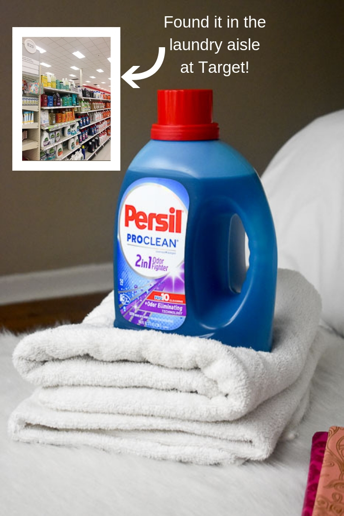 Persil laundry detergent on stack of fresh white towels