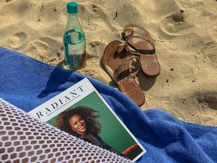 black women's beach essentials, on Waimanalo Beach, Oahu