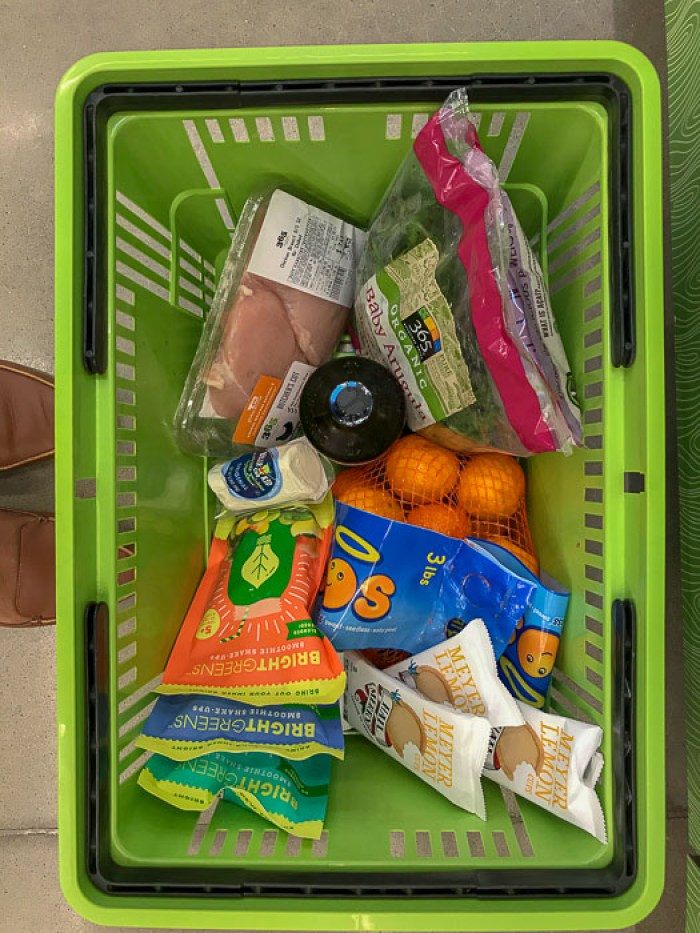 hand basket of groceries at Whole Foods Market 365