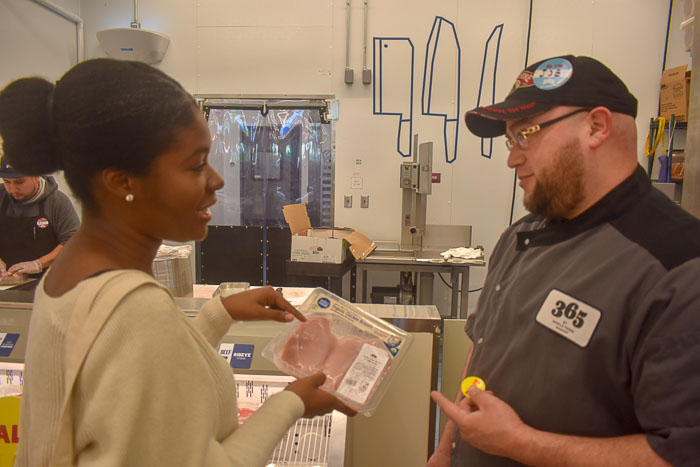 Dash of Jazz discussing chicken cuts with Whole Foods Market 365 butcher