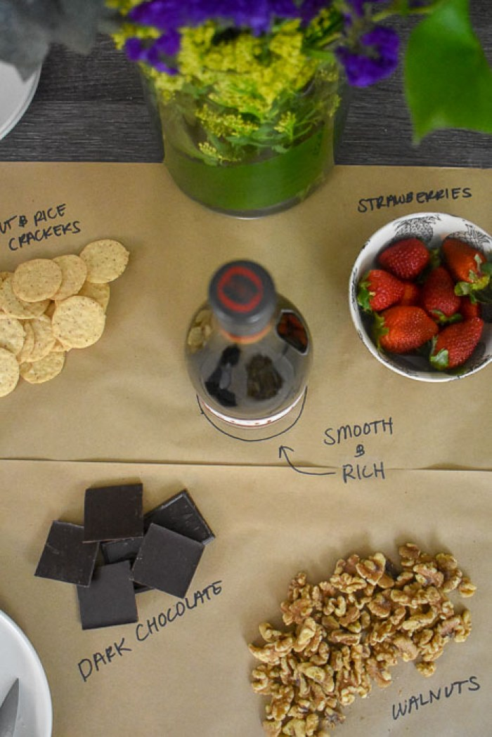 spread of wine and snacks on butcher paper