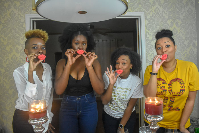 black women holding kiss cookies
