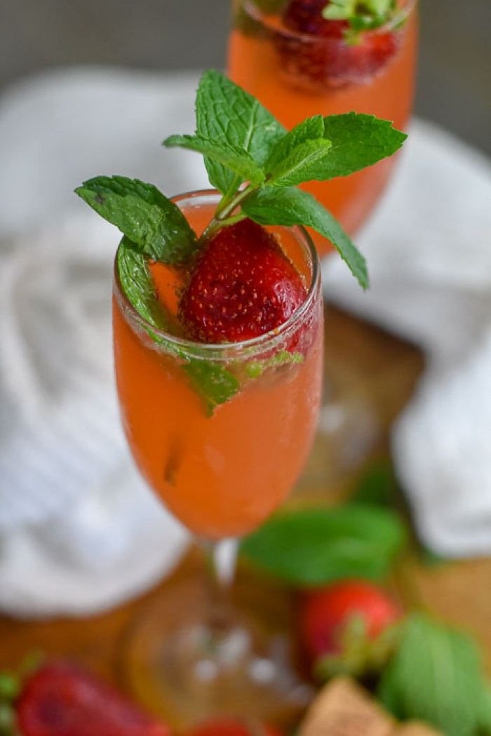 strawberry mint mimosas with fresh strawberries and mint