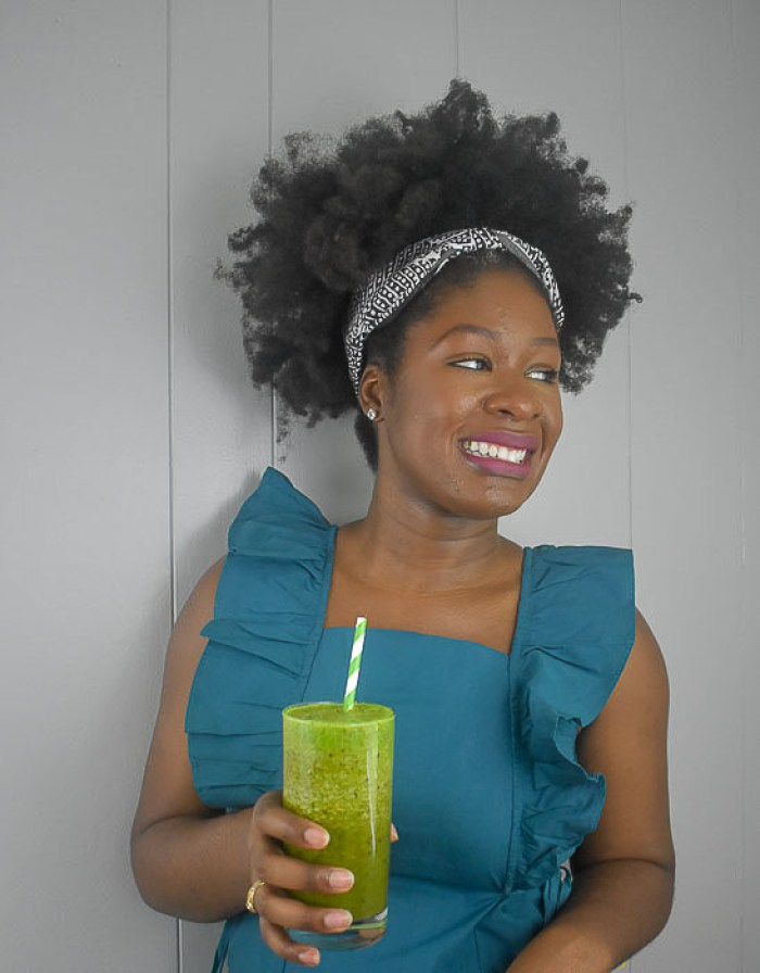 Dash of Jazz holding glowing green smoothie