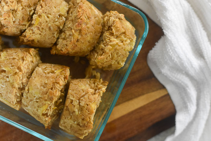 baked pina colada oatmeal muffins in glass container
