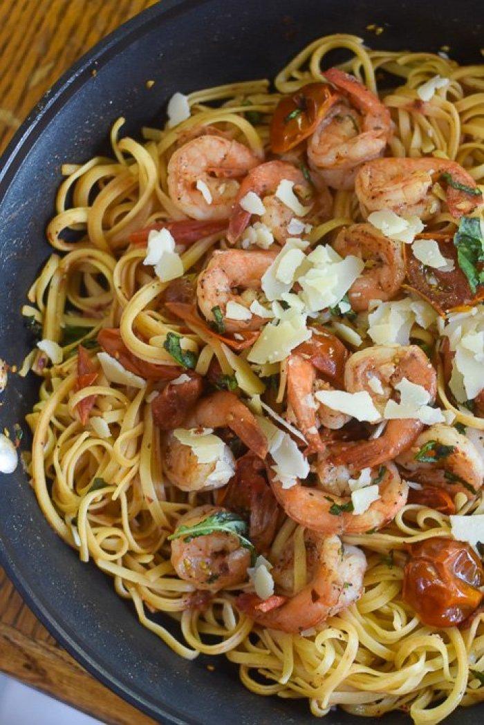 spicy shrimp tomato pasta dinner in skillet