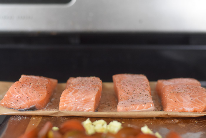 seasoned salmon on cutting board