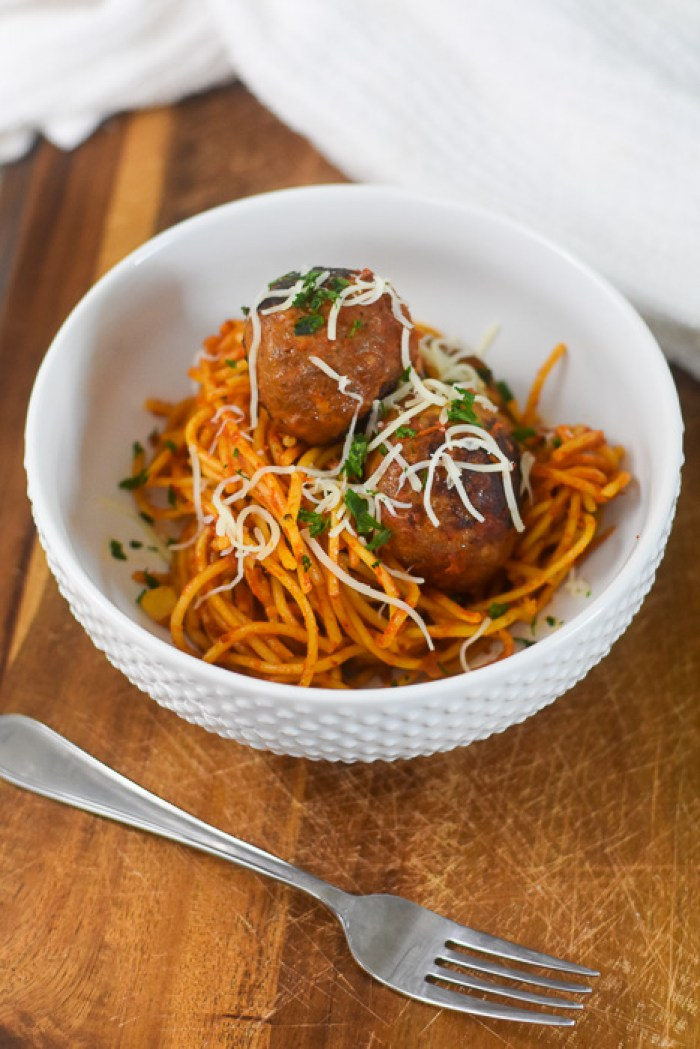 baked spaghetti & meatballs in white bowl