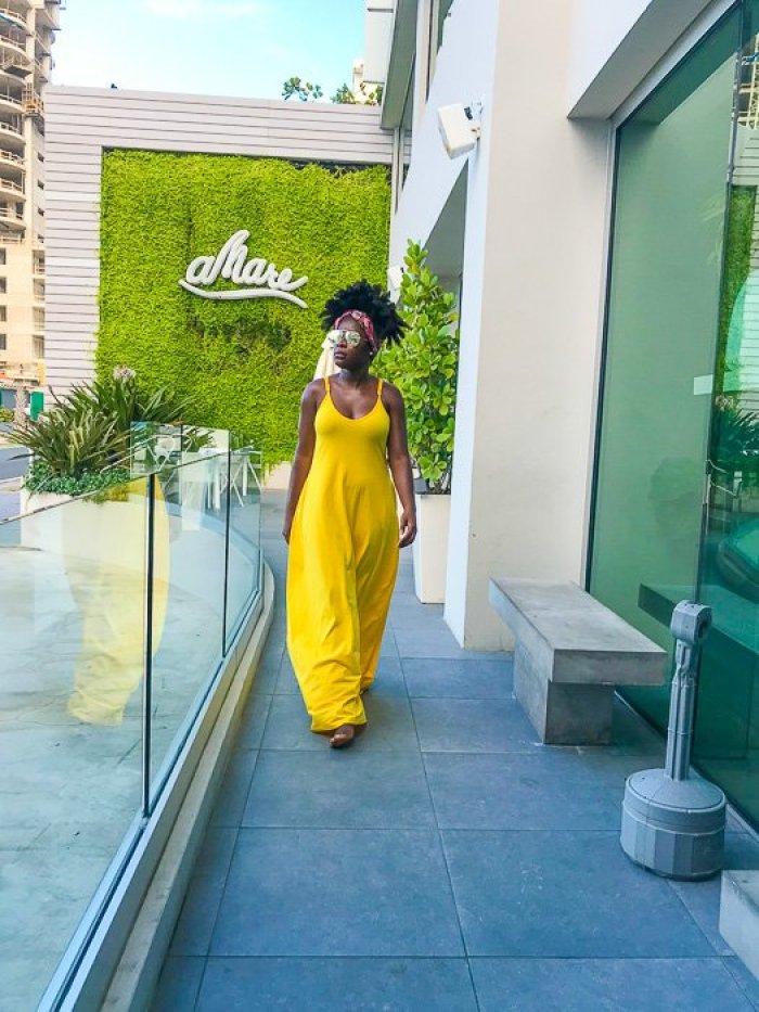 Dash of Jazz wearing yellow maxi dress outside Serafina Beach Hotel