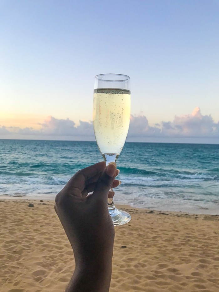 champagne toast against Condado Beach backdrop