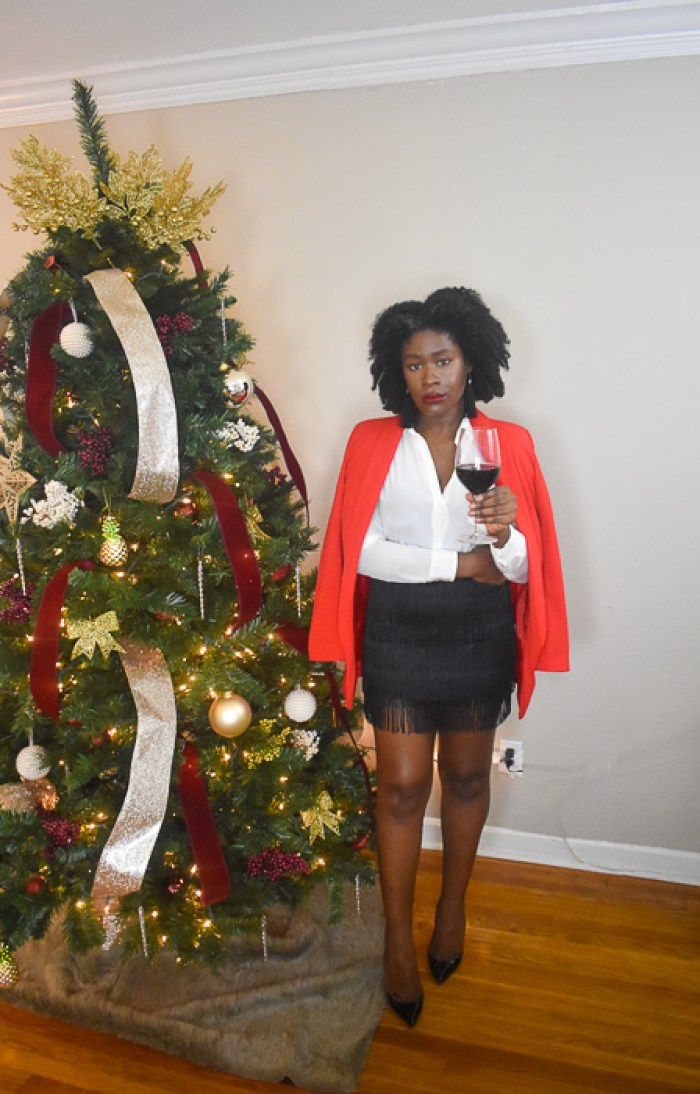 Dash of Jazz in tassel miniskirt and red blazer