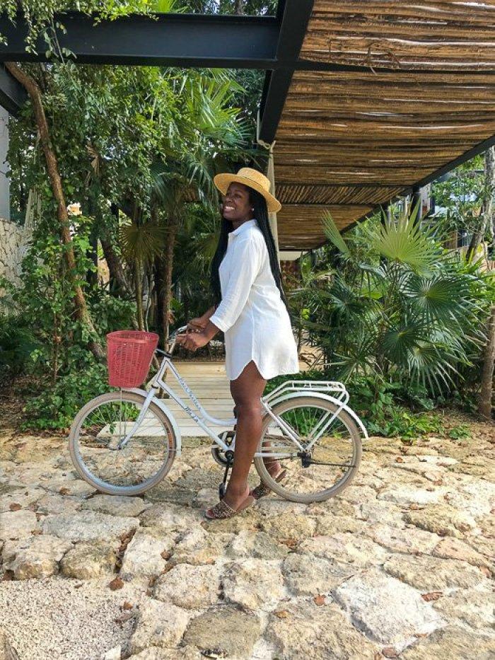 Dash of Jazz riding bike in Tulum