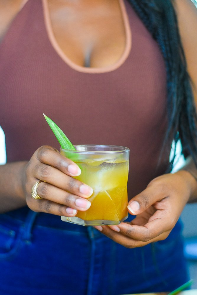 holding brown sugar pineapple whiskey sipper