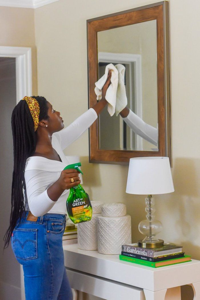 Jazzmine wiping mirror with white towel