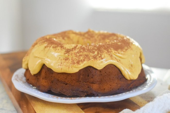 Peanut butter chocolate pound cake topped with peanut butter frosting