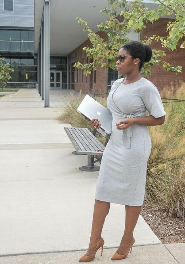 Jazzmine standing outdoors holding laptop